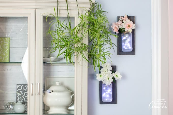 mason jar wall sconces hanging on wall
