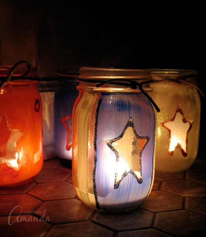 painted jars in the dark lit up with candles