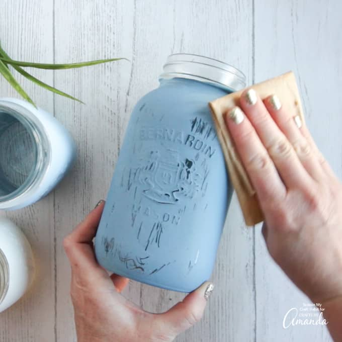 after painting the mason jar, sand it down with fine grit sandpaper