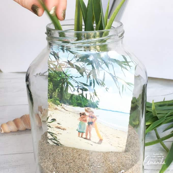 adding greenery to jar