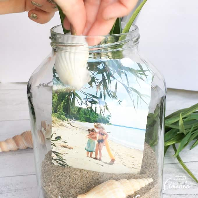 adding sea shells to jar