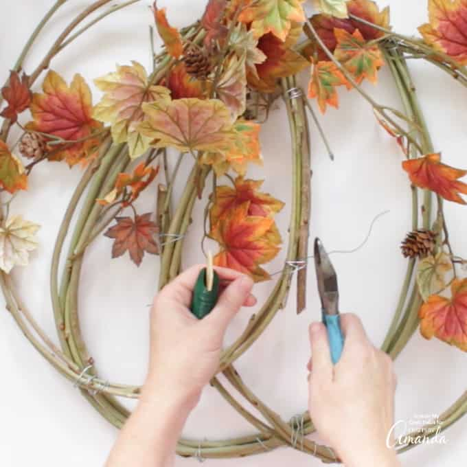 using floral wire to attach the faux foliage