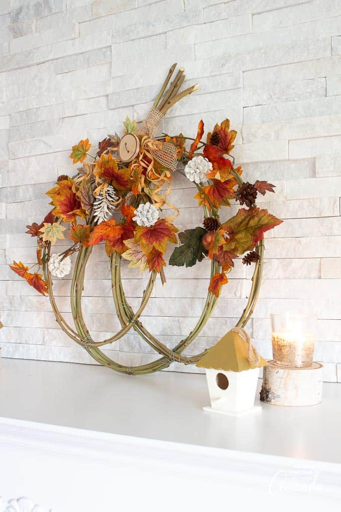fall foliage inspired pumpkin grapevine wreath