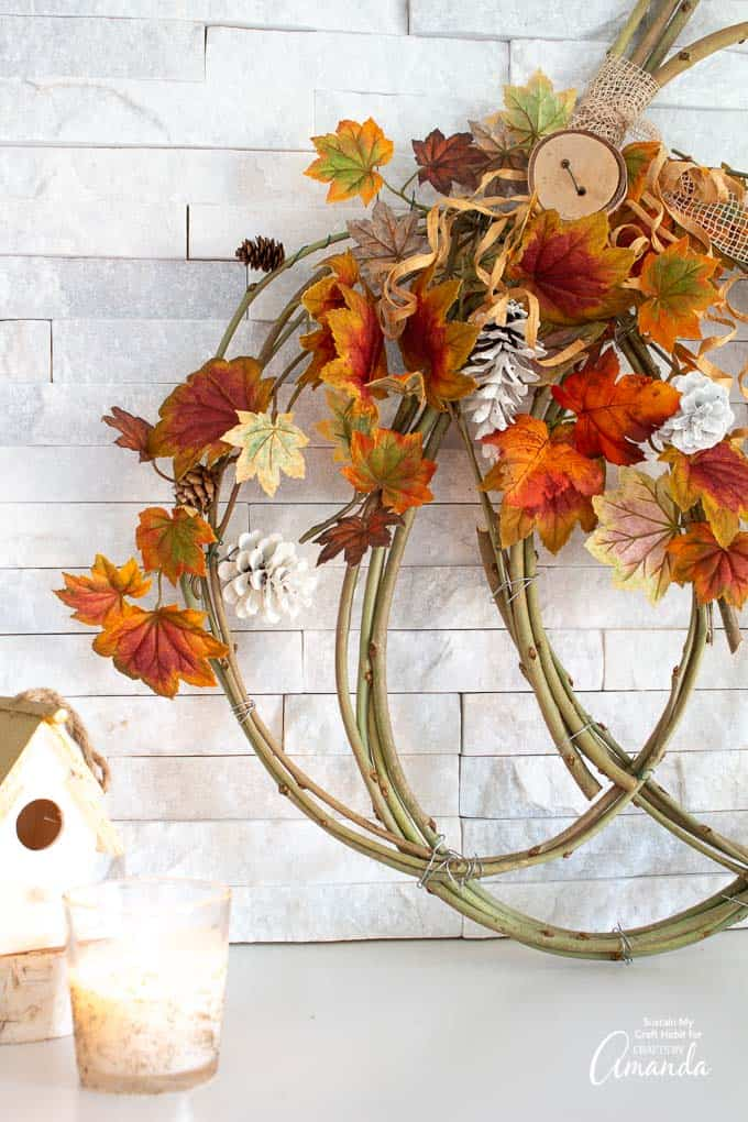 pumpkin grapevine wreath against wall