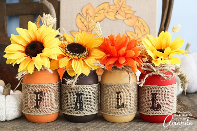 painted mason jars in fall colors with burlap