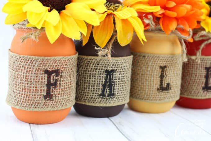 letters stamped onto burlap ribbon on mason jars