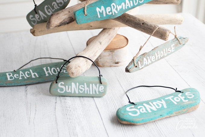 beach sign ornaments made from driftwood with phrases