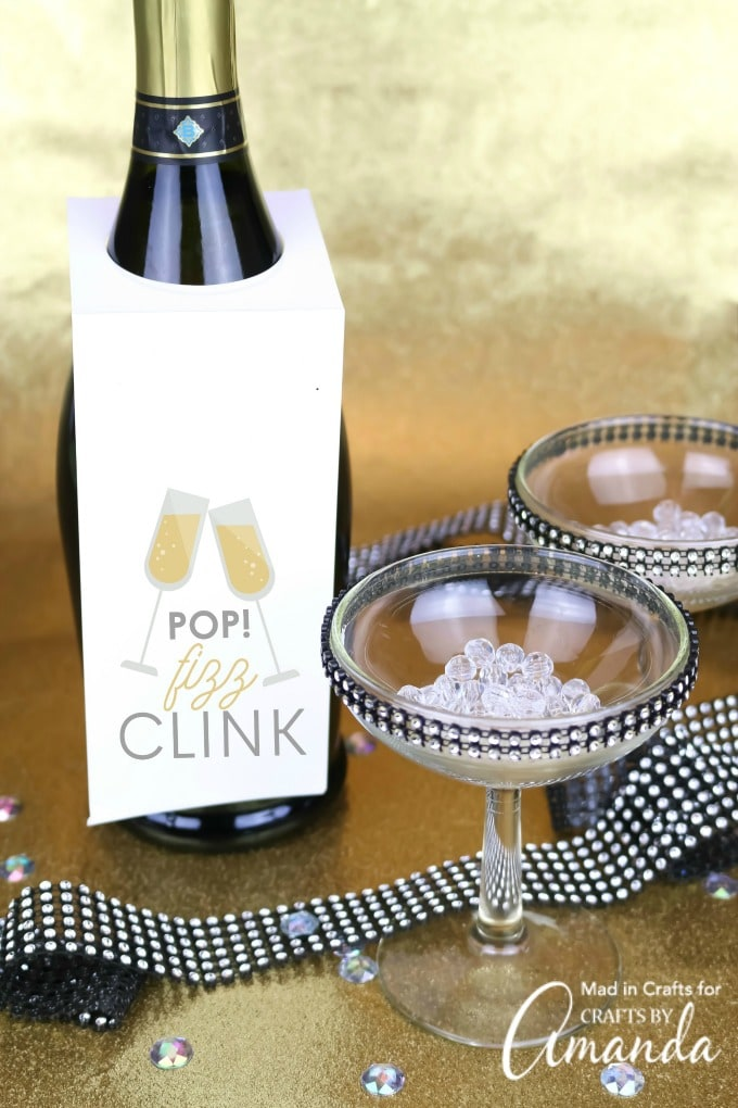 martini glasses and champagne bottle with new year bottle tag