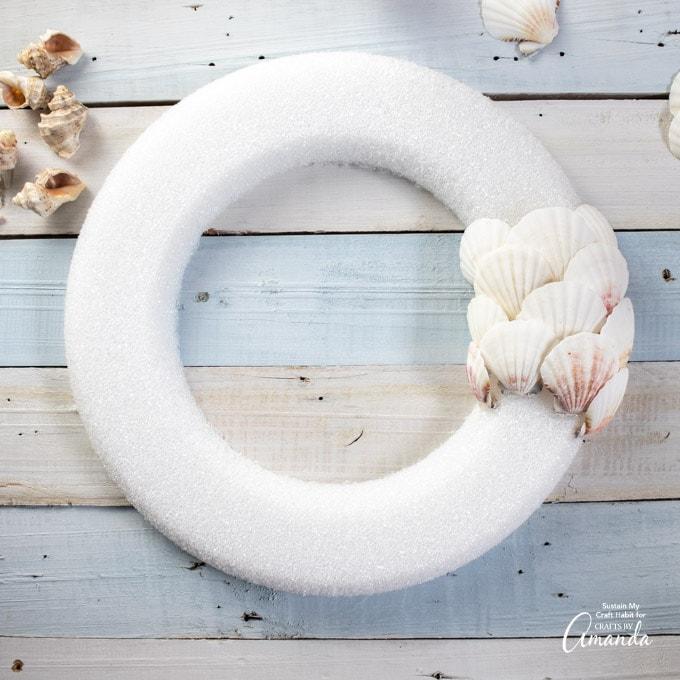 adding seashells to wreath form