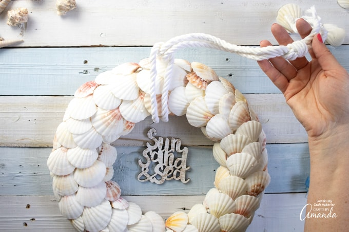 tying rope to wreath
