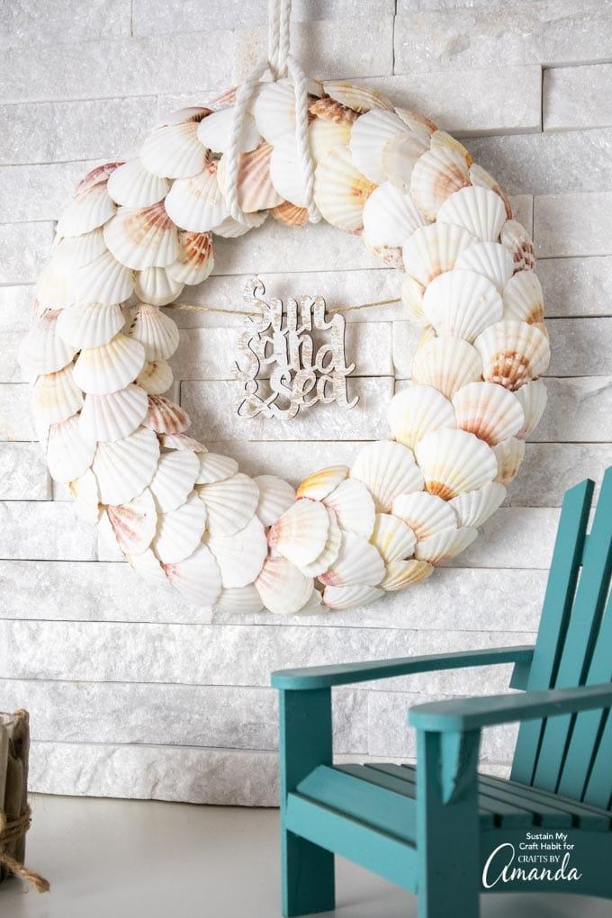 seashell wreath hanging on wall