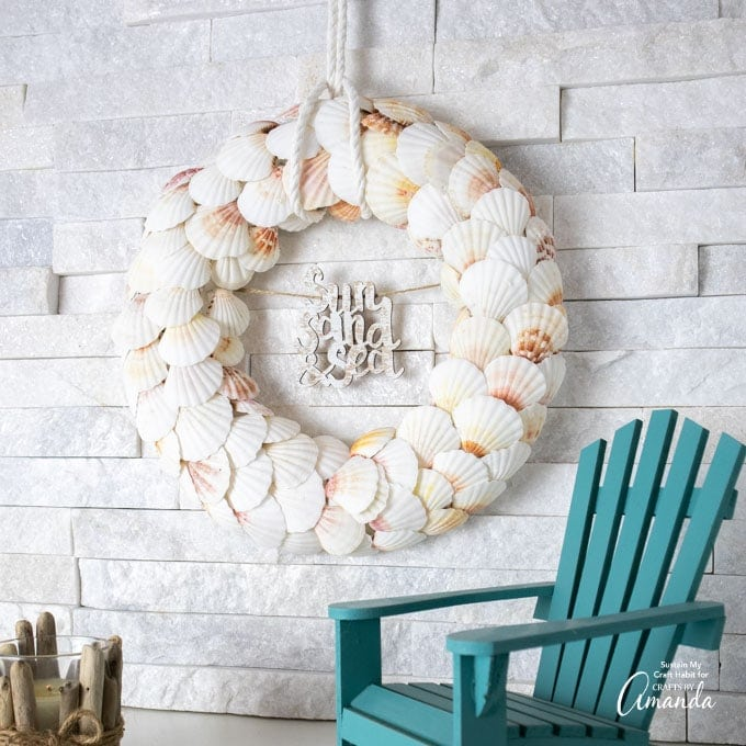 Sea shell wreath hanging on wall