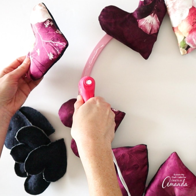 attaching large hearts to hoop wreath