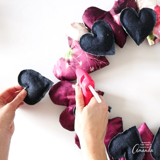 attaching small hearts to wreath