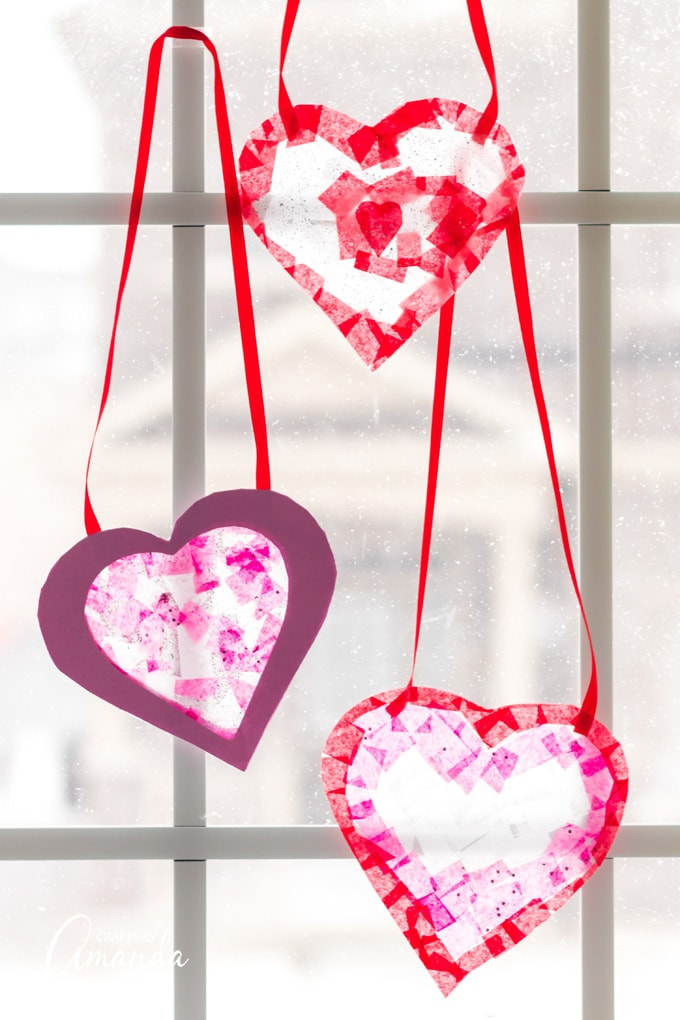 3 heart shaped suncatchers in a window
