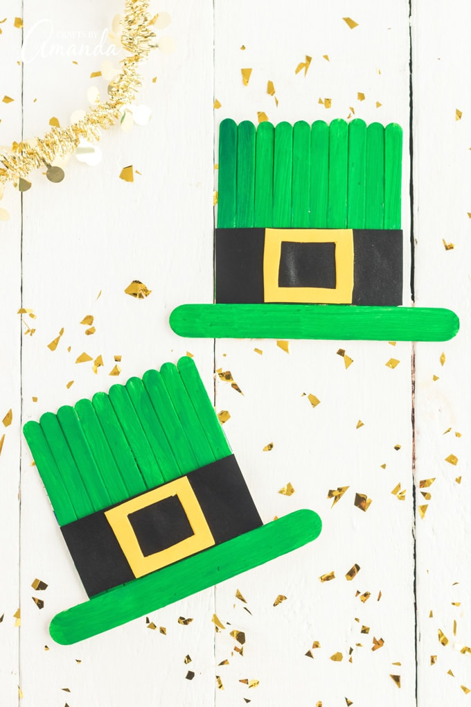 two craft stick leprechaun hats