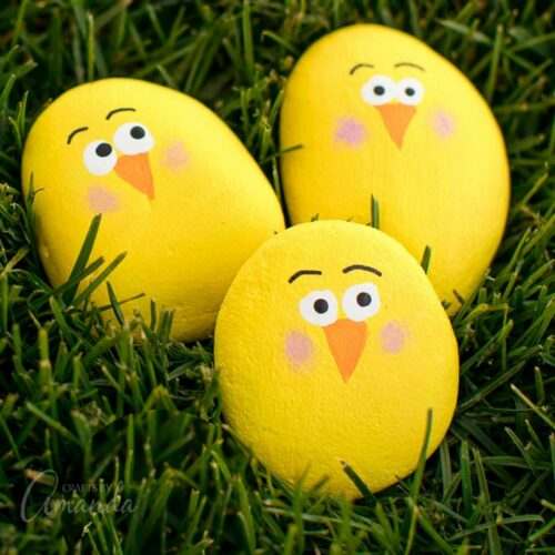 painted rocks - yellow chicks in grass