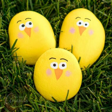3 yellow painted rocks chicks in grass