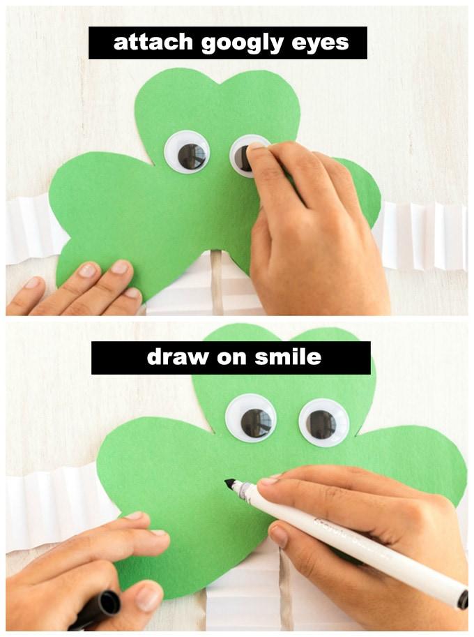 glueing googly eyes onto shamrock paper craft