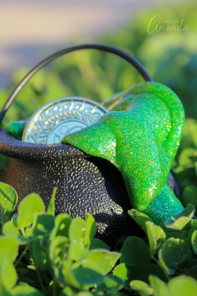 green st patricks day gliter slime in black cauldron