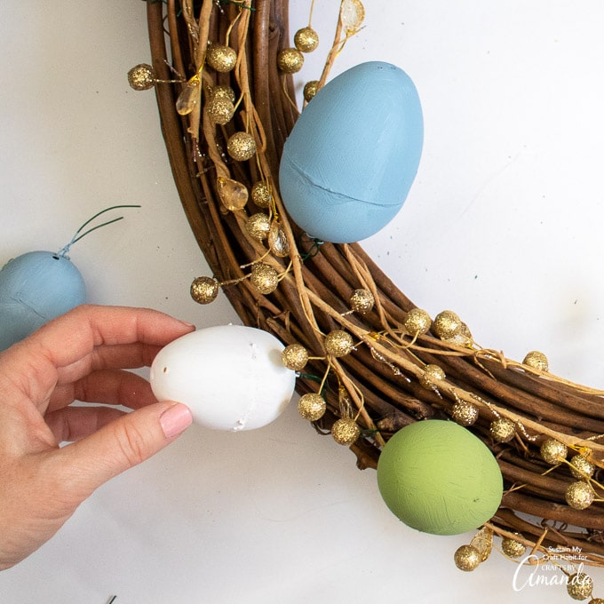 using floral wire to attach plastic easter eggs