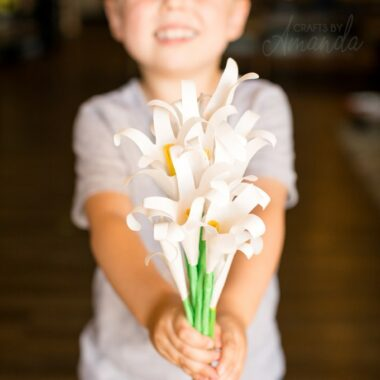 boy holding handprint easter lily bouquet