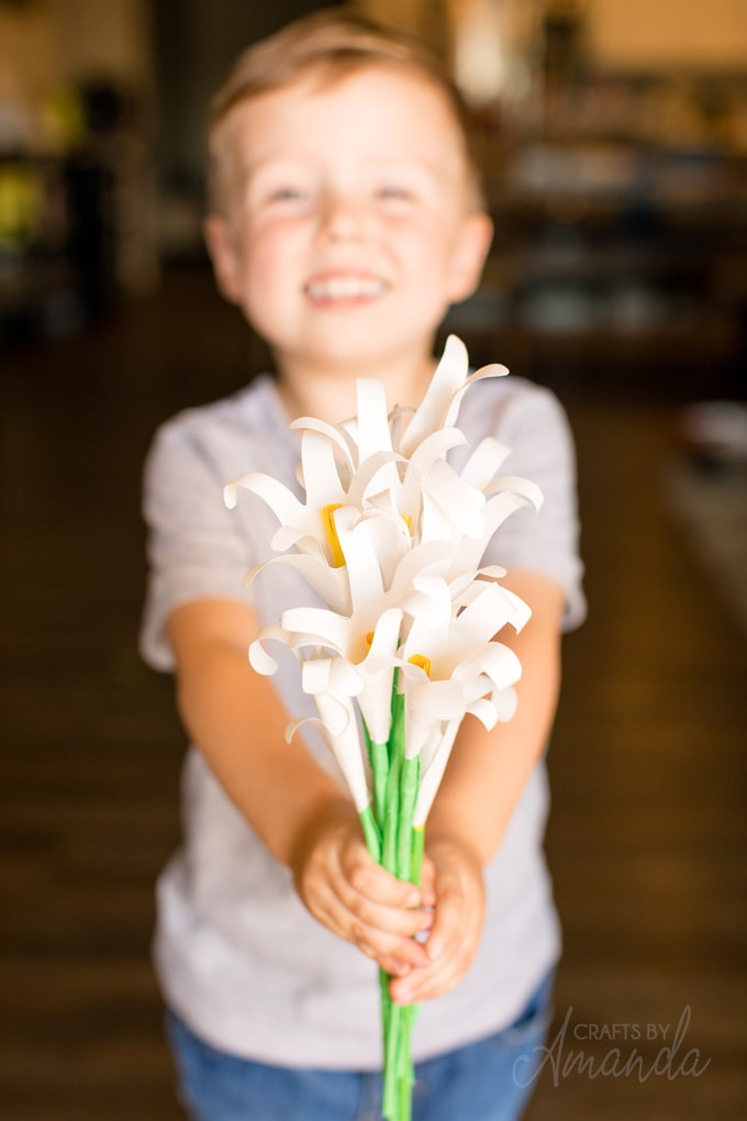 LITTLE BOY HODLING BOUQUET OF HANDPRINT EASTER LILIES