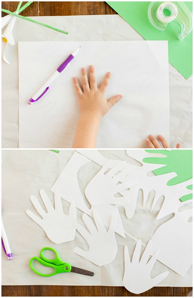 tracing child's hand on construction paper
