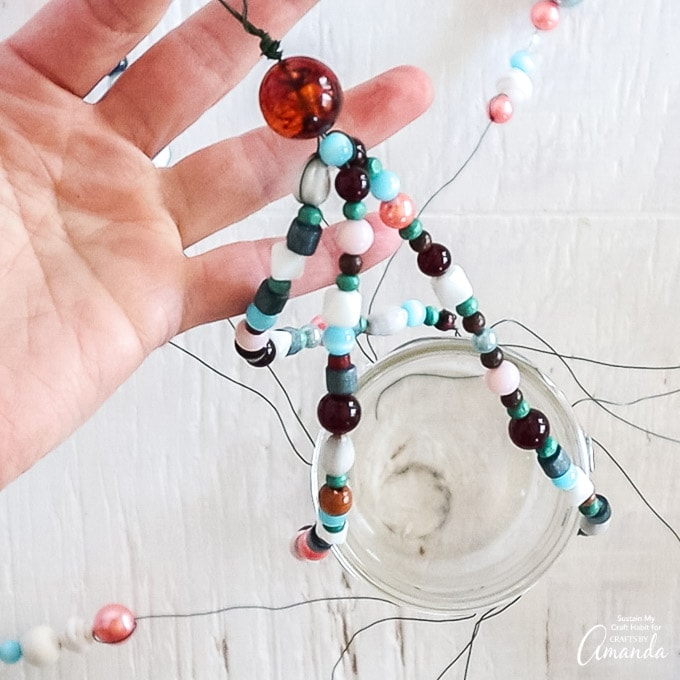 create loop with excess wire about shortest beaded strands