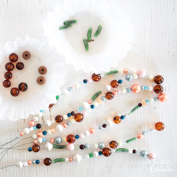 prepare 6 strands of glass beads in various sizes and shapes and colors