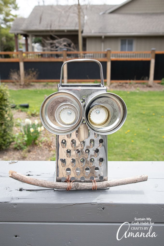 cheese grater owl styled in the garden