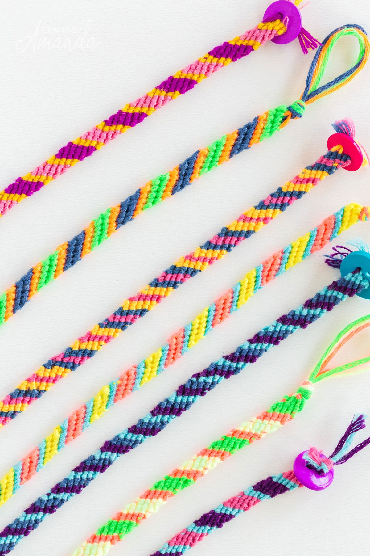 several friendship bracelets laying on a table