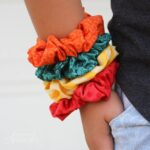 colorful DIY scrunchies on a girl's wrist