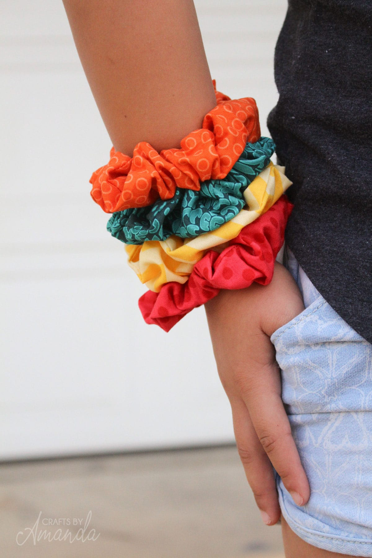 colorful scrunchies on a little girl's wrist