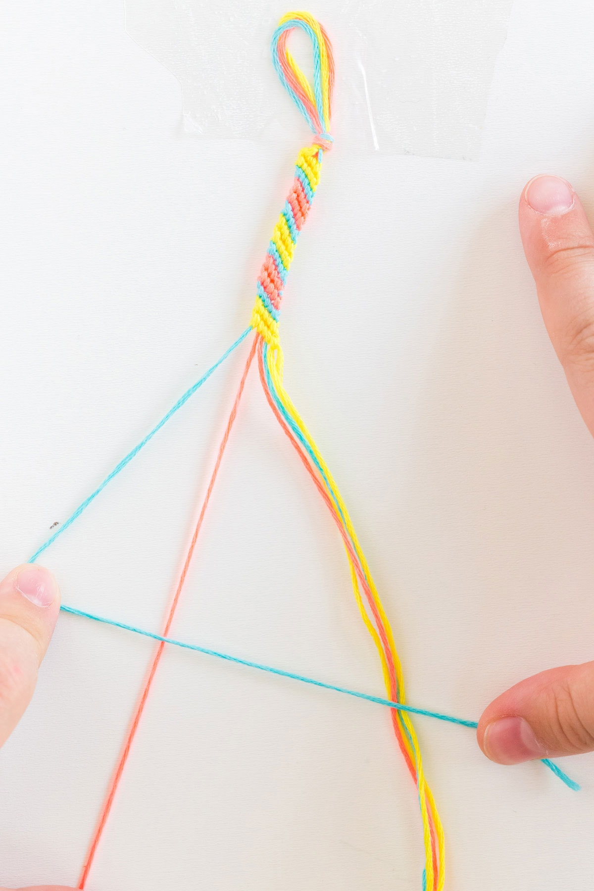 weaving a friendship bracelet