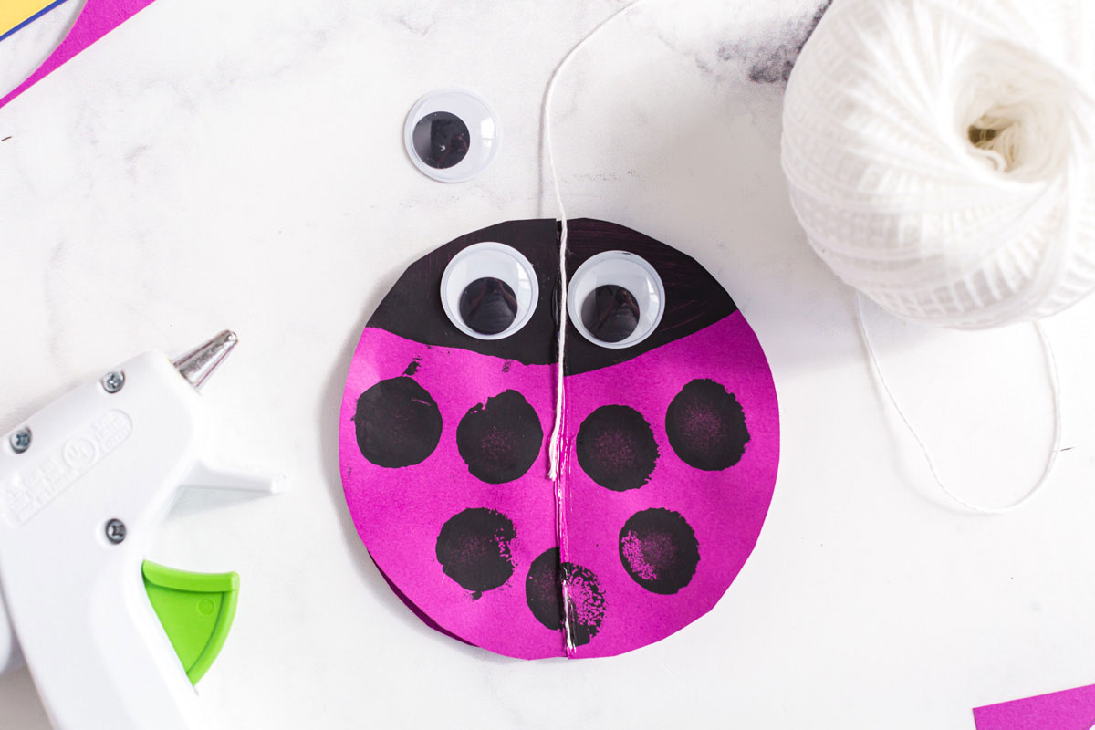 string glued to paper ladybug