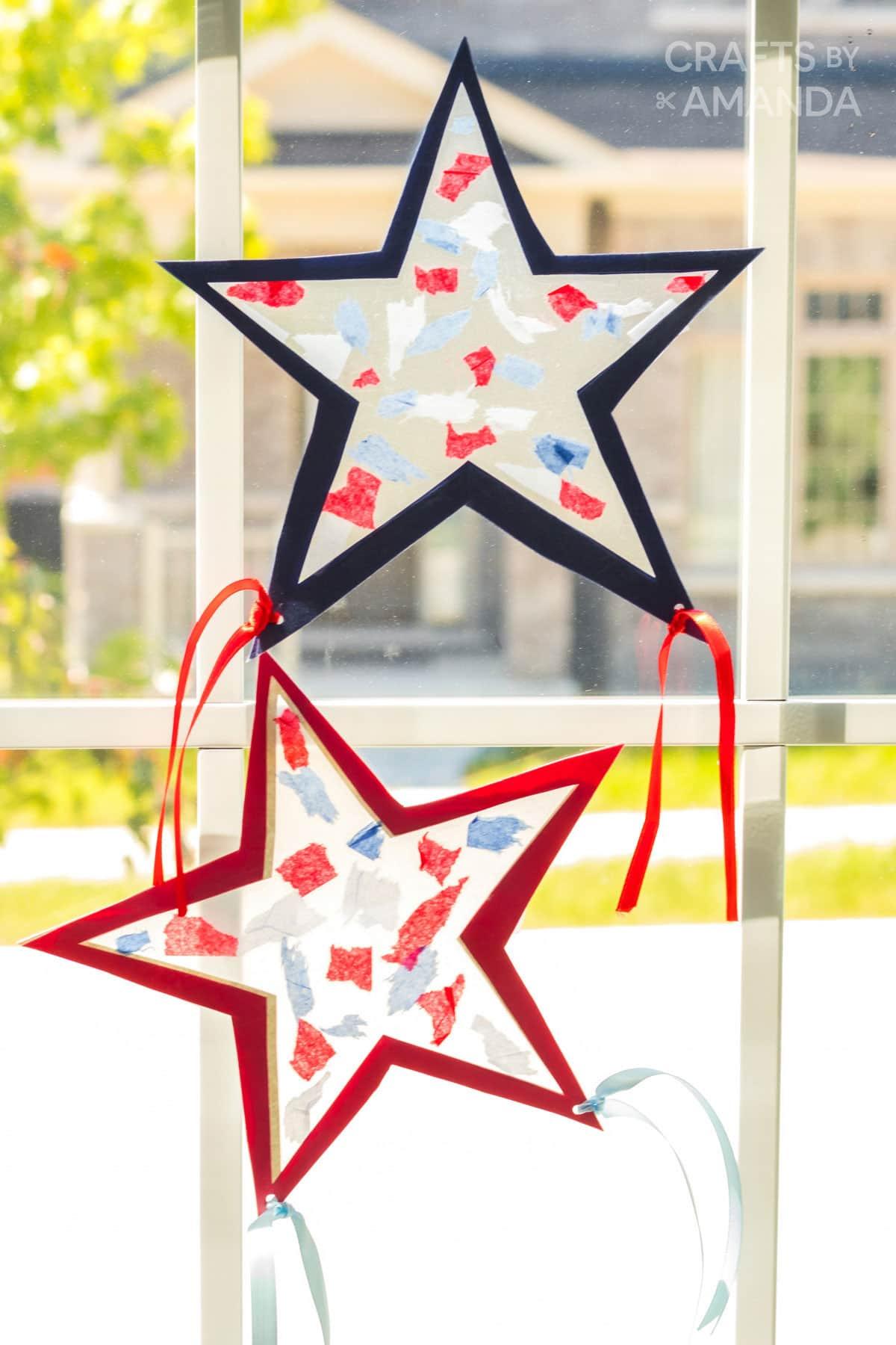 two star shaped suncatchers in a windw