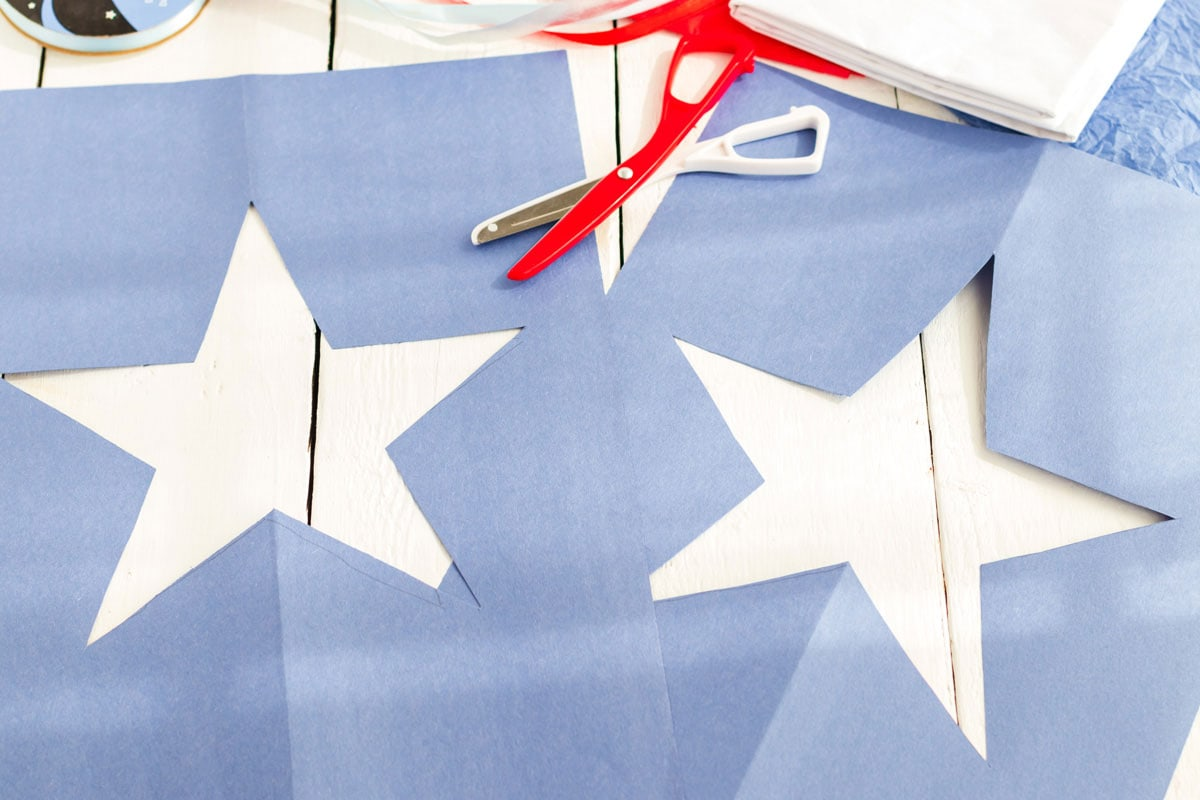 two stars cut from blue construction paper