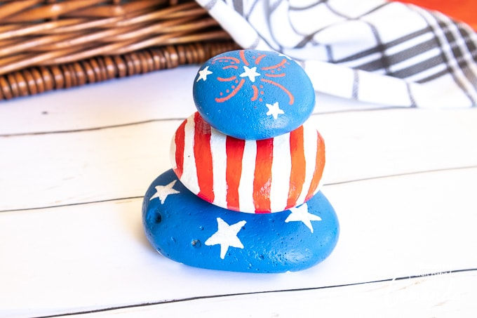 patriotic painted rocks stacked on top of eachother