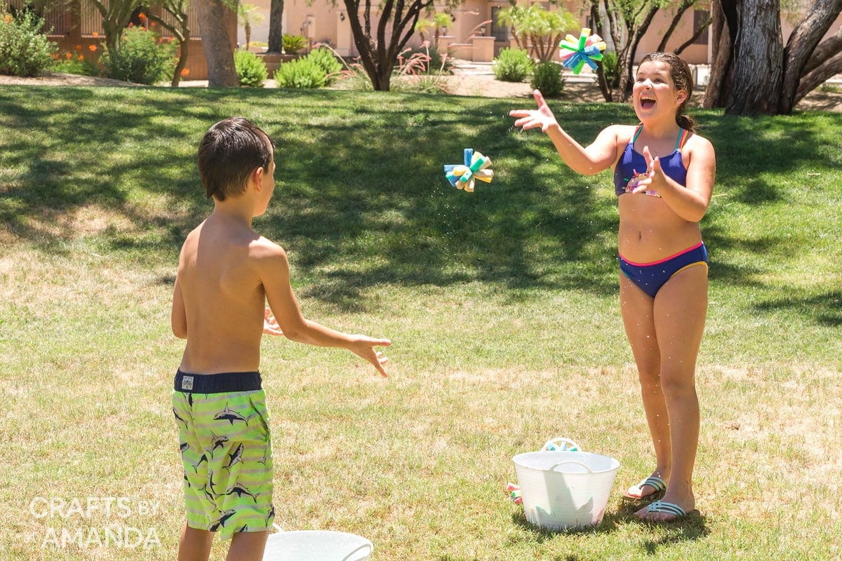 kids tossing sponge bombs to each other