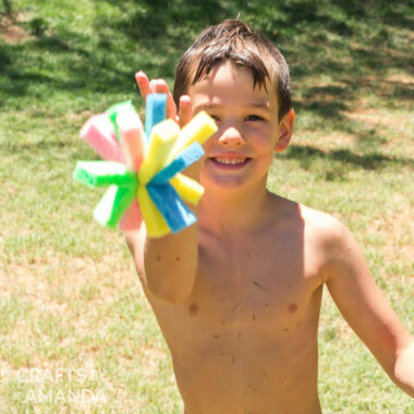 boy tossing a sponge bomb at the camera