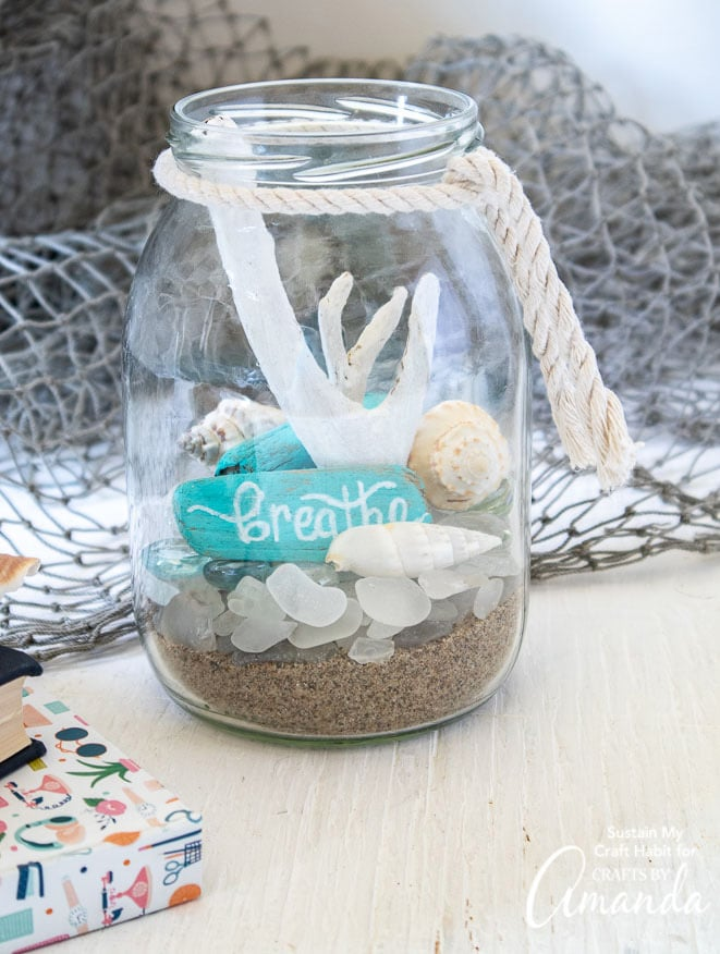 jar filled with beach items