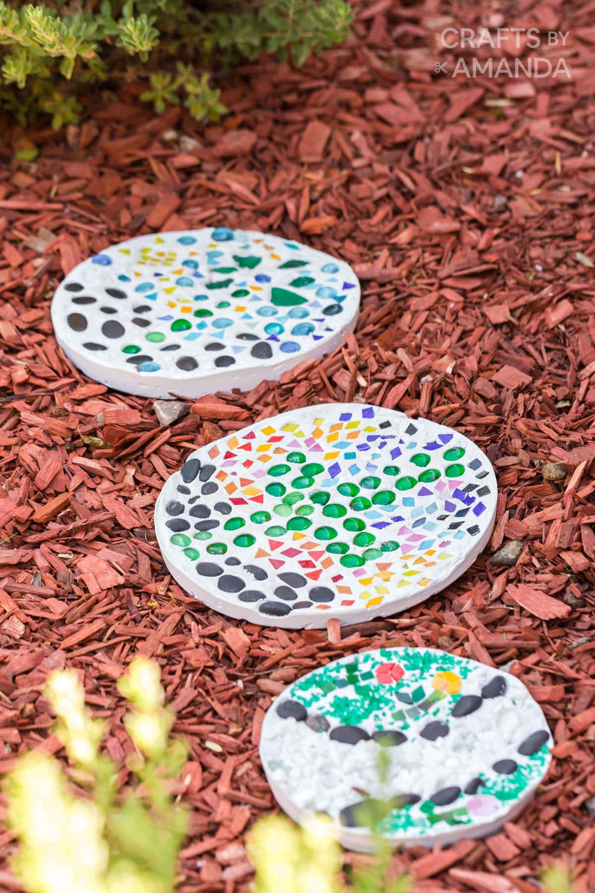 3 garden stepping stones in red mulch