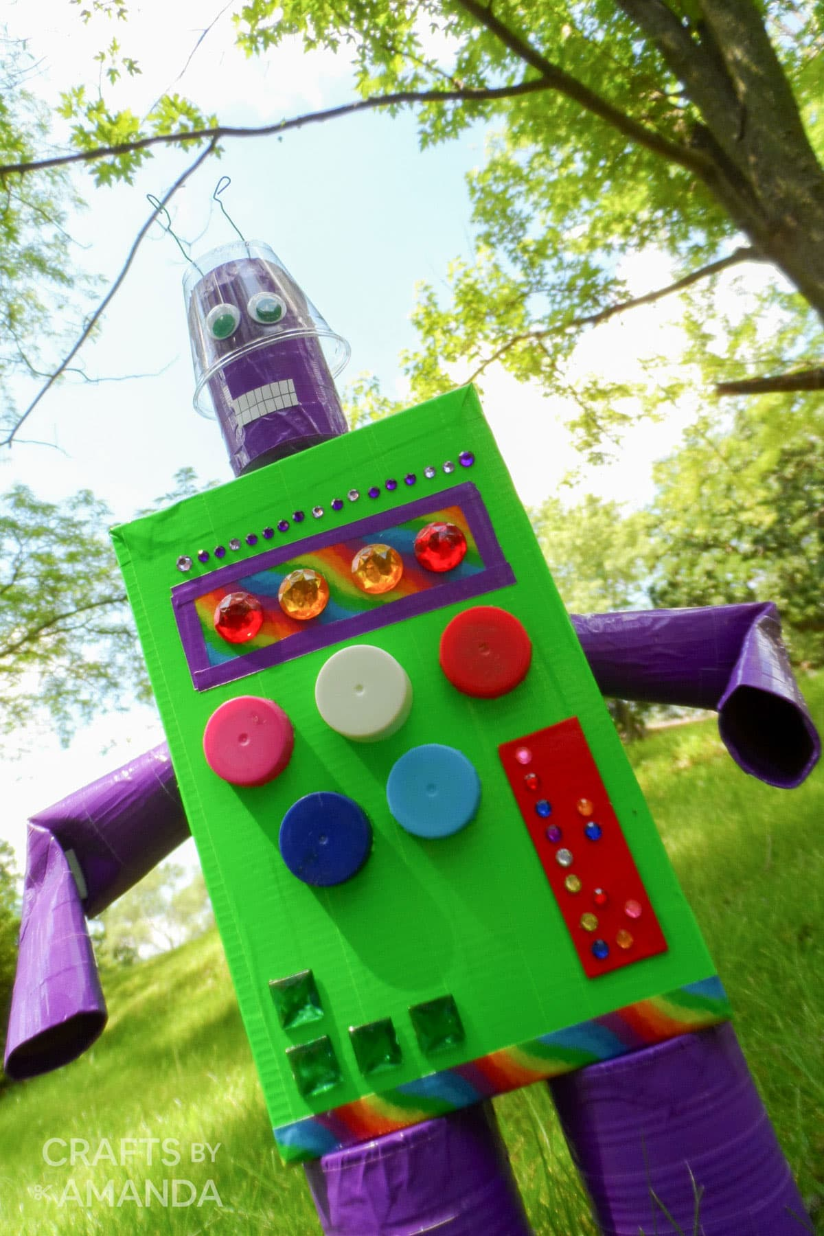robot made from cereal box in the backyard
