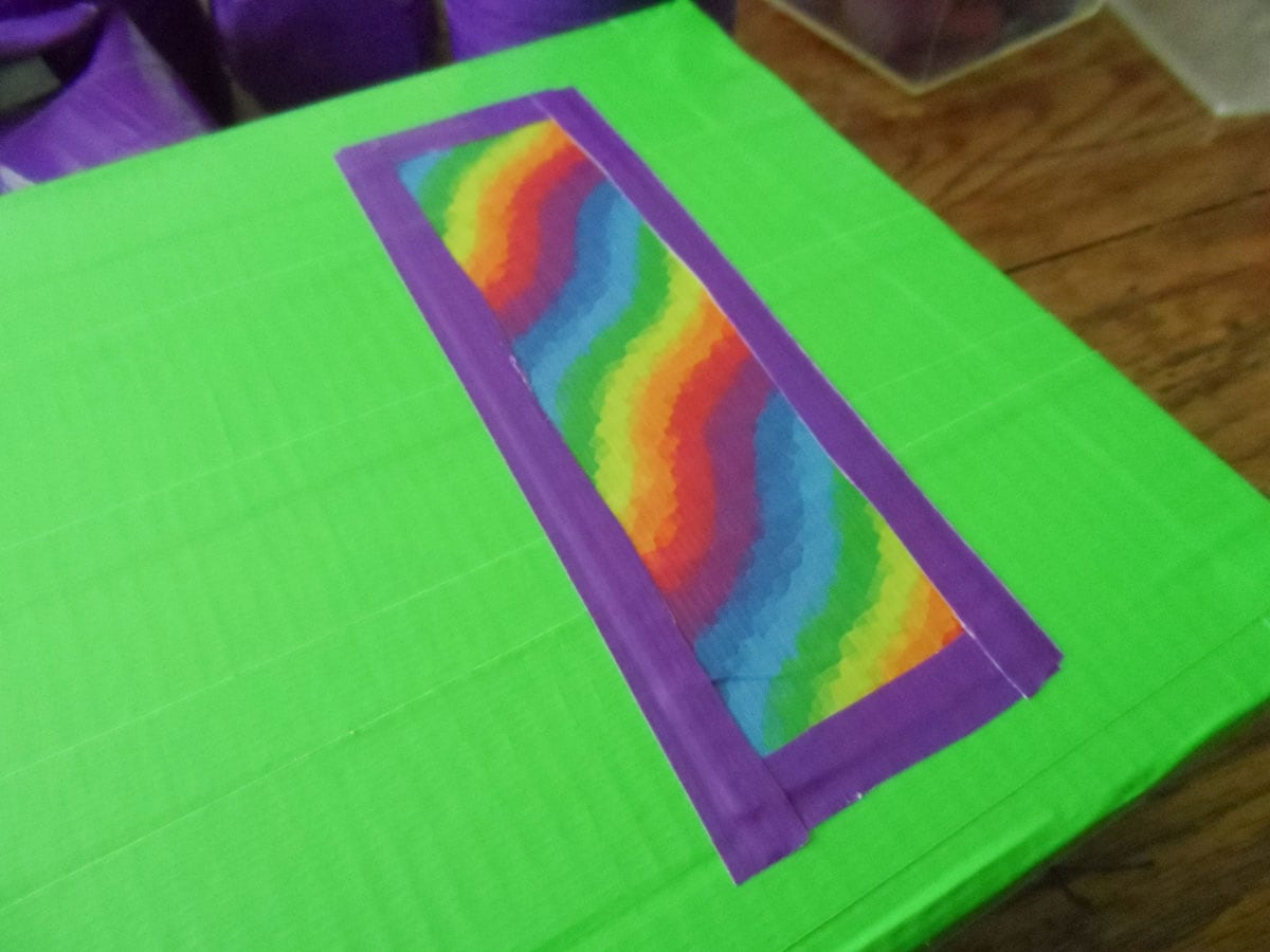 rainbow duct tape over green an purple duck tape on cereal box