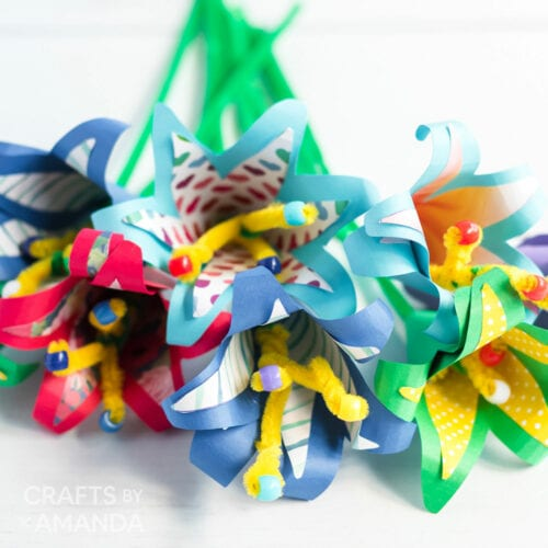 several paper flowers sitting on a table