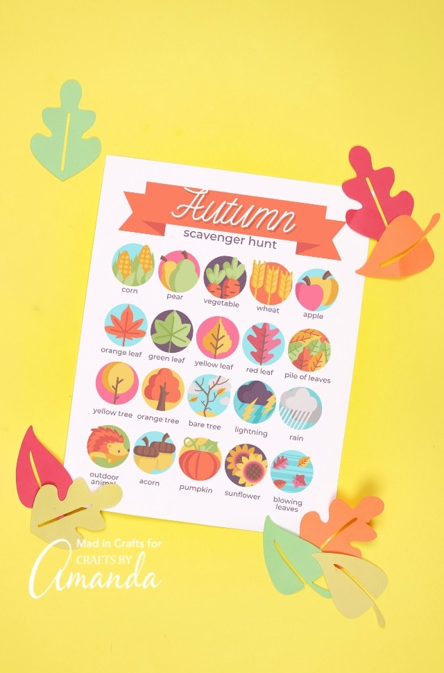 fall scavenger hunt with felt leaves on yellow backdrop