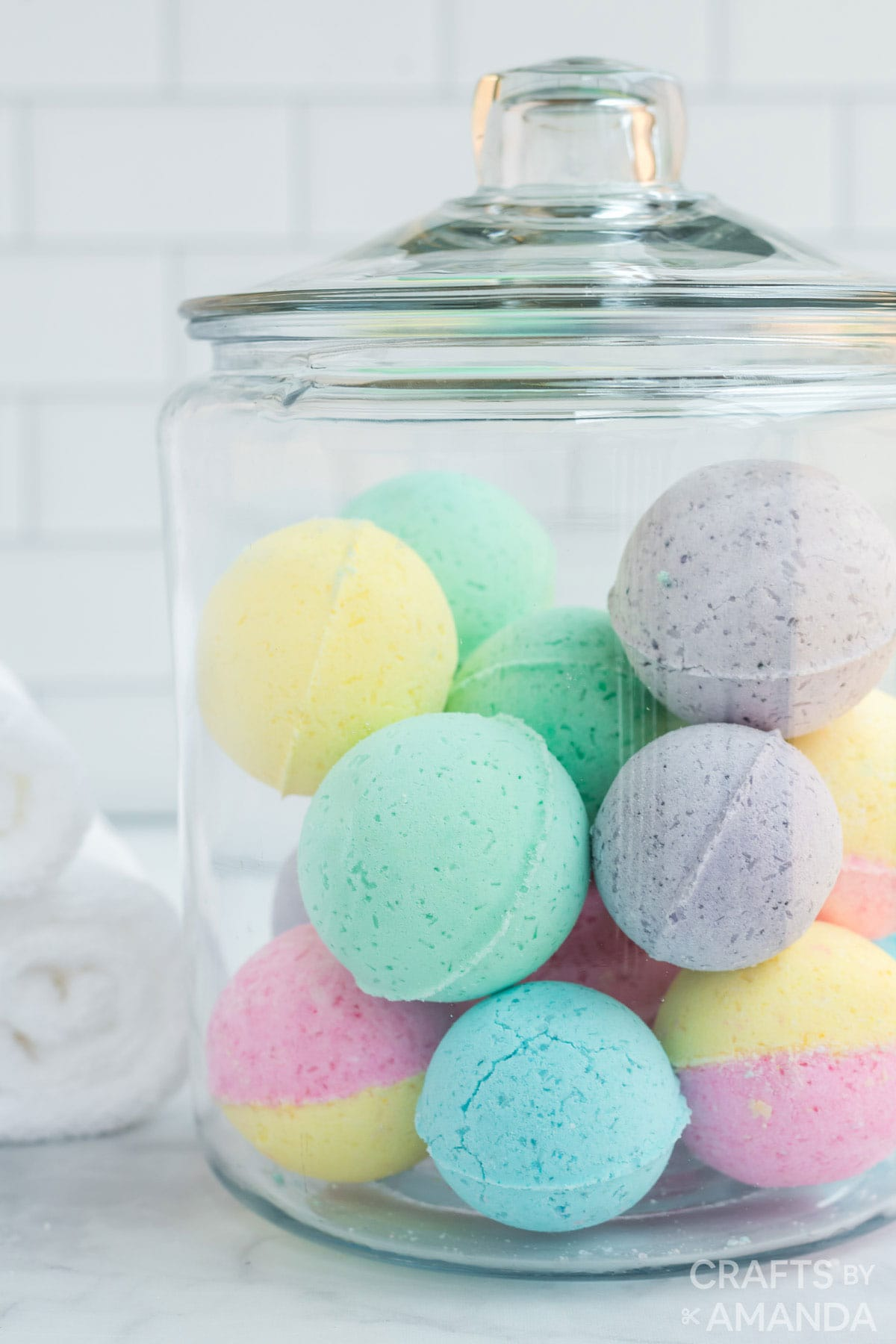 glass jar filled with colorful bath bombs