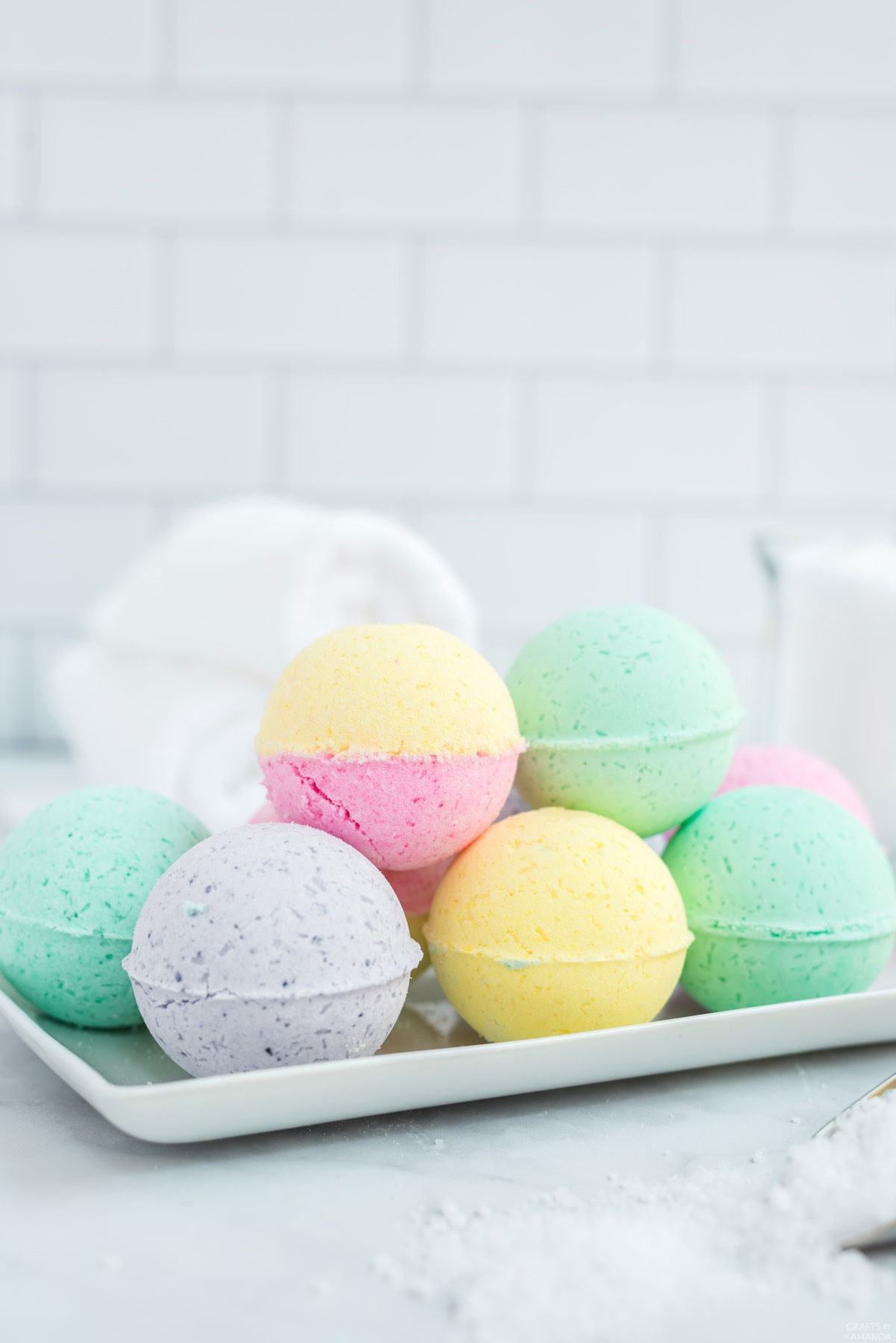 tray of colorful bath bombs on bathroom counter