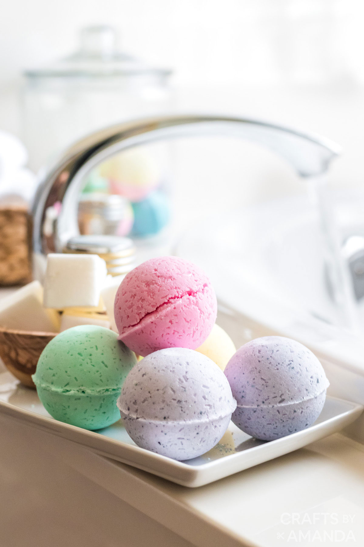 bath bombs on the side of the bathtub